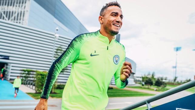 BUOYANT BRAZILIAN: A delighted Danilo strides out