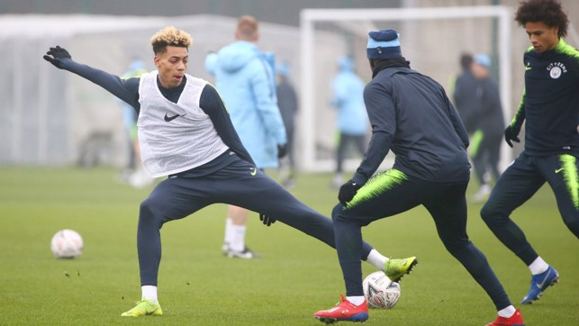 UNDER CONTROL: Felix Nmecha stretches to keep possession