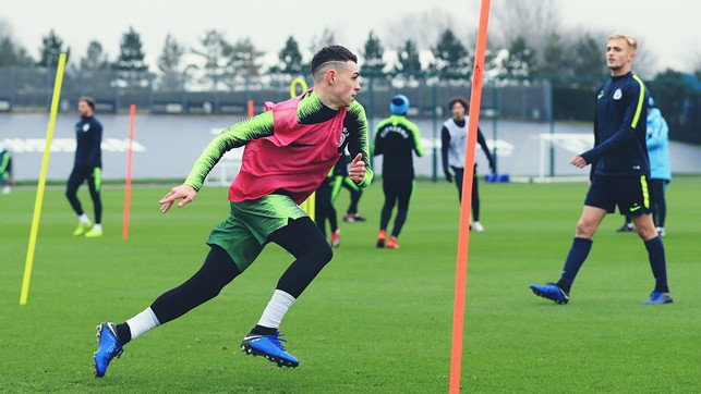 PHIL YOUR BOOTS! Phil Foden puts in some leg work