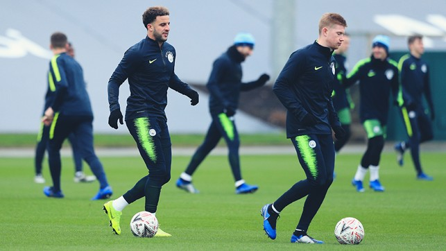 TWO'S COMPANY: Kyle Walker and Kevin De Bruyne limber up for action