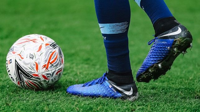 BIG BOOTS TO PHIL: Young Foden shows off his custom footwear