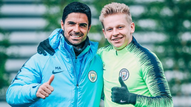 THUMBS UP: All smiles from Mikel Arteta and Oleksandr Zinchenko