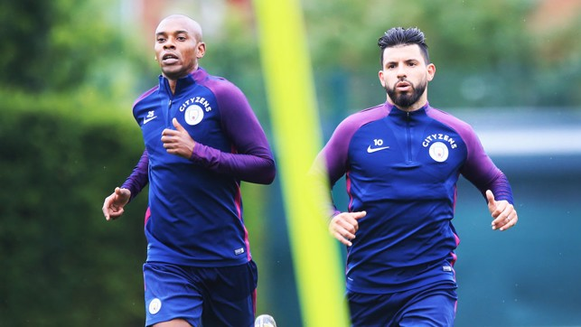 IN ACTION: Fernandinho and Sergio Aguero on the move