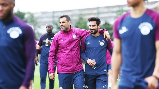 GUNDO: Ilkay and physio Edu Alvarez share a joke