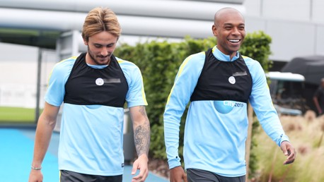 Aleix Garcia and Fernandinho arrive for training.