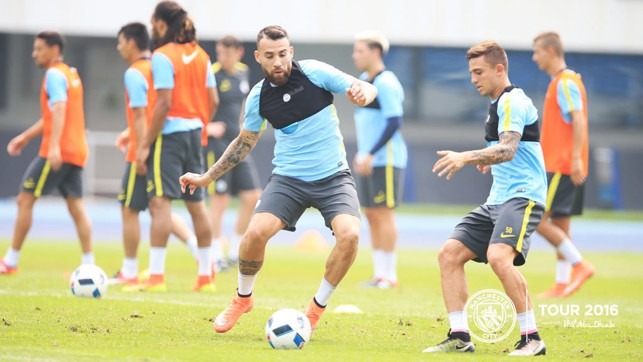 FOCUS: Otamendi and Maffeo have their eyes on the ball.