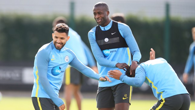 WATCH THE HAIR: Yaya messes with Raheem Sterling's 'do.