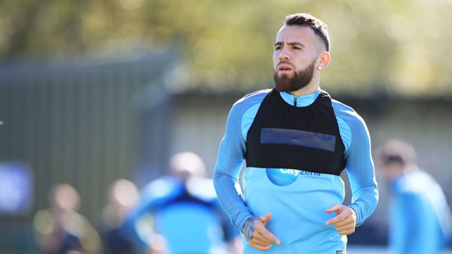 THE GENERAL: Otamendi warms up for the session