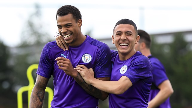 SMILE LIKE YOU MEAN IT: Lukas Nmecha and Ian Poveda enjoy a joke