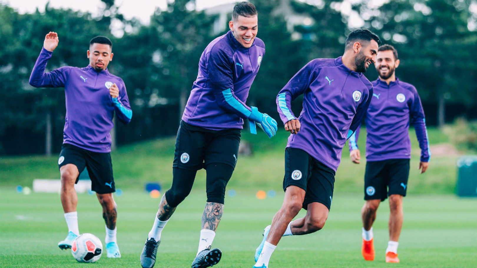 QUICK GET AWAY: The chase is on between Ederson and Riyad Mahrez!