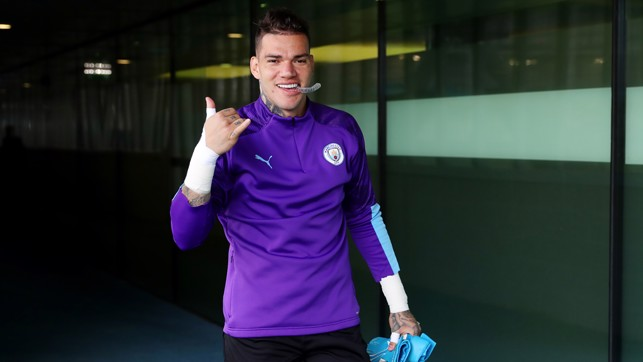 ALL SMILES: Ederson heads out for training.