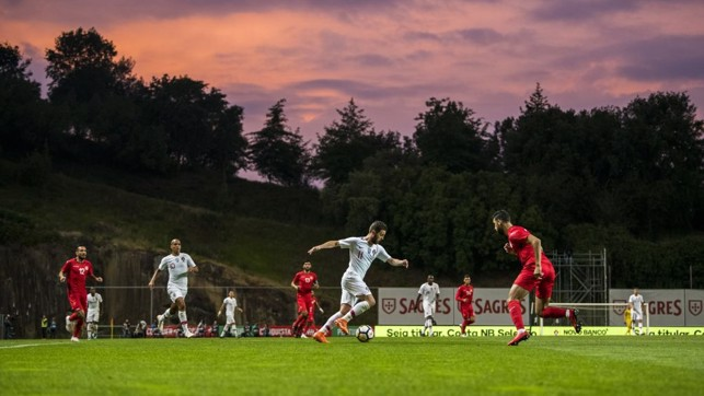 TRICKY: Bernardo Silva embarks on a trademark run against Tunisia.