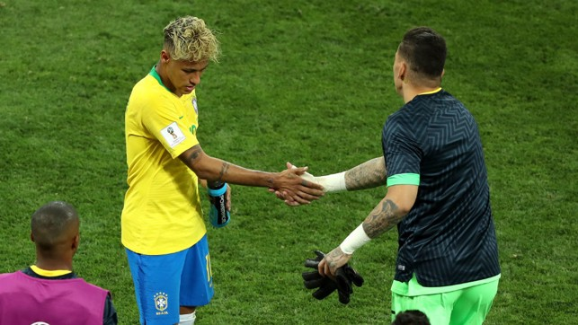 GIVE HIM A HAND: Ederson, who was on the bench for Brazil, shakes hands with Neymar