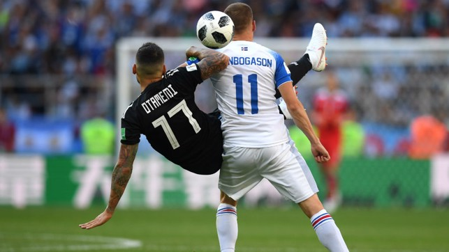 THE GENERAL: Nicolas Otamendi goes in on Finnbogason