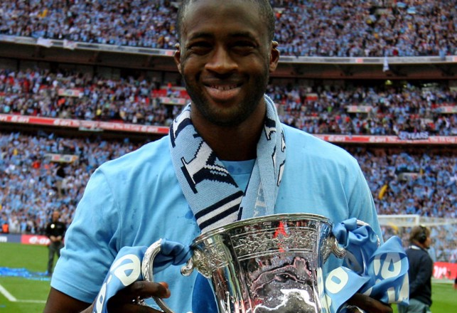 PRIZE GUY: Toure with the FA Cup in 2011