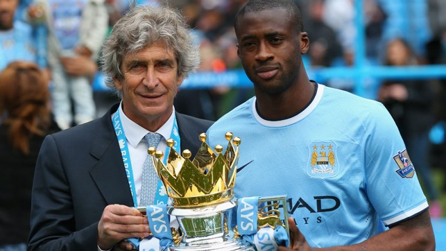 PREMIER LEAGUE CROWN: Toure with the trophy and Manuel Pellegrini in 2014