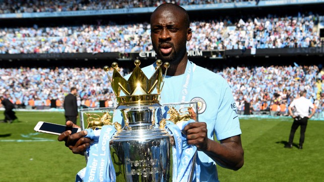 GOING OUT AT THE TOP: Yaya with the 2017/18 Premier League trophy
