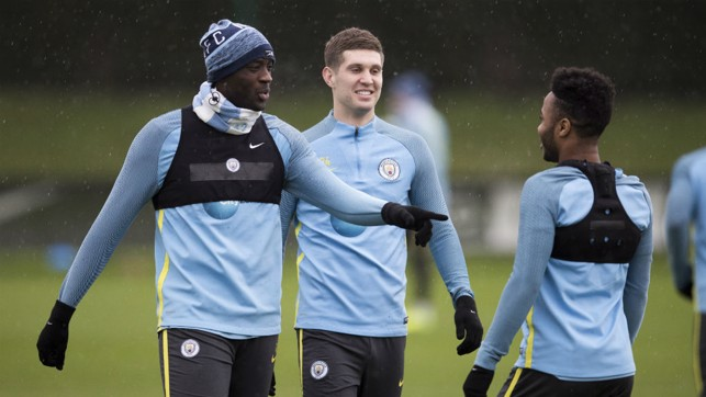 EXPERIENCE AND YOUTH: Toure offers a pointer to Raheem Sterling in training