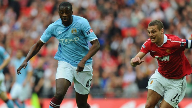 TOURE DE FORCE: Yaya in action against Nemanja Vidic in the 2010/2011 FA Cup