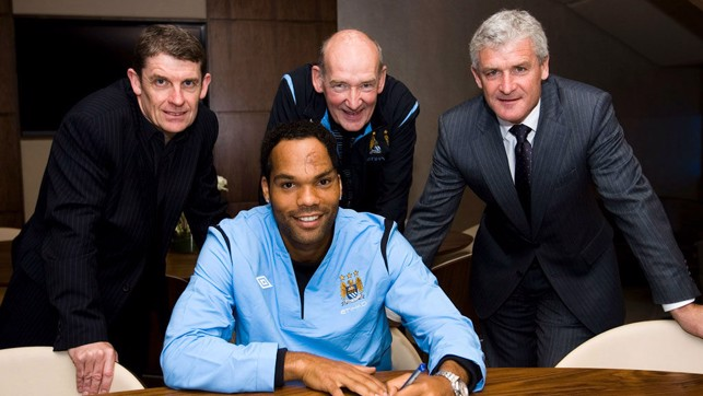 SIGN LANGUAGE: Flashback to 2009 and Bernard looks on along with Brian Marwood and former manager Mark Hughes as Joleon Lescott signs for City