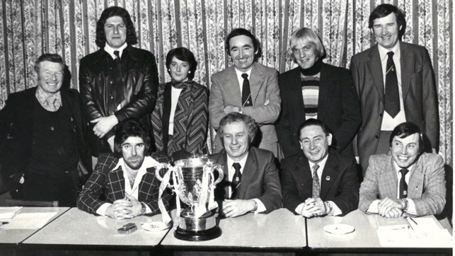 CUP WINNERS: Bernard (back row far right), along with former chairman Peter Swales and guests proudly poses with the League Cup