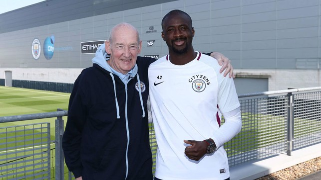 WARM EMBRACE: Bernard shares a smile with former City midfield powerhouse Yaya Toure