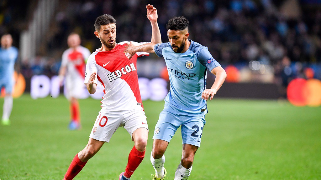 Silva tussles with Gael Clichy during the recent Champions League clash