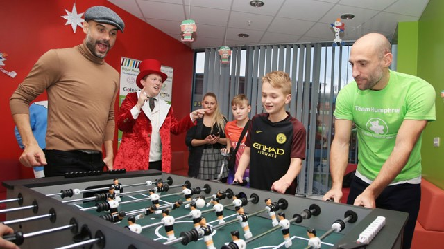 FOOSBALL: Pep Guardiola and Pablo Zabaleta have a go at the table version of the beautiful game
