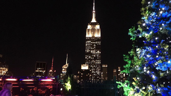 EMPIRE STATE OF MIND: Asllani enjoying cocktails with a view.