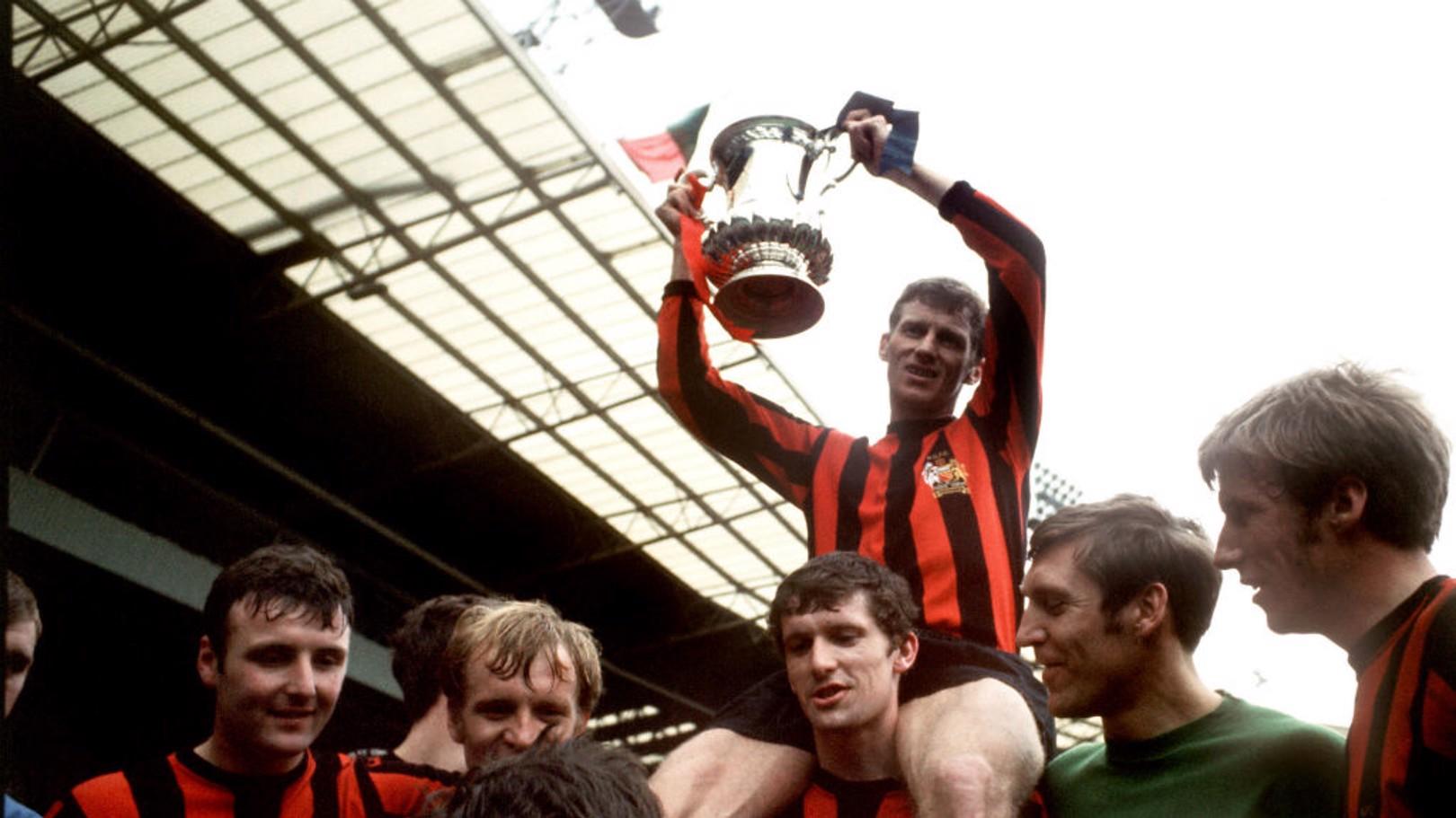 RETRO: Tony Book lifts the FA Cup.