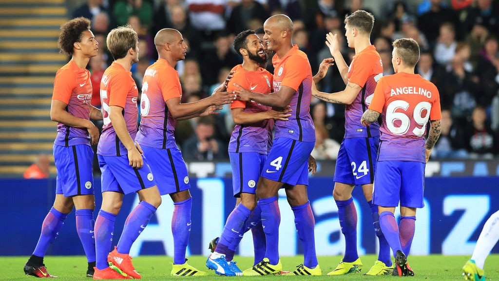 Gael Clichy celebrates with his teammates