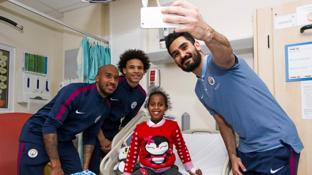 SELFIE: Ilkay Gundodan captures a special photo for one youngster.