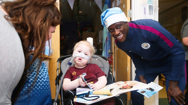 GIFTS: Ben Mendy hands over some Christmas presents.