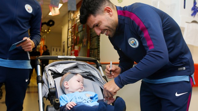 SIGNED: Sergio adds his name to this little Blues' shirt.