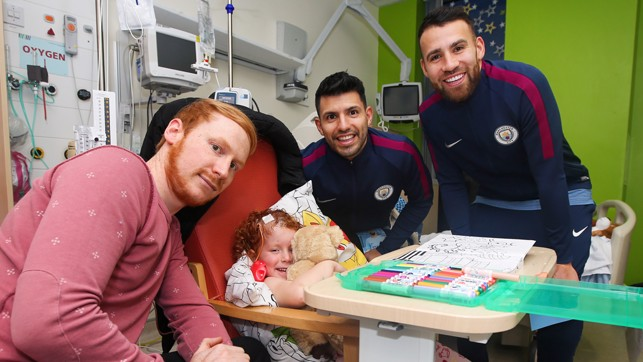 FESTIVE CHEER: Sergio and Nico pay a visit to one patient's bedside.