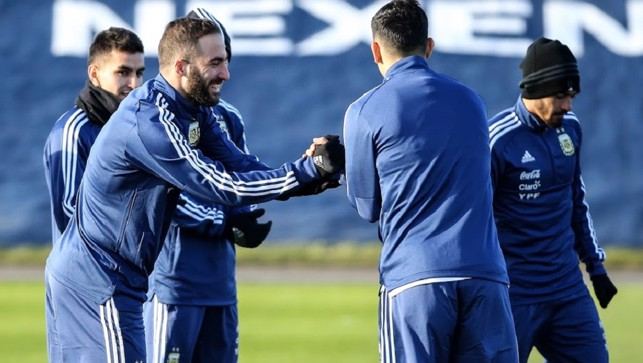 PALS: Higuain enjoys a smile and joke