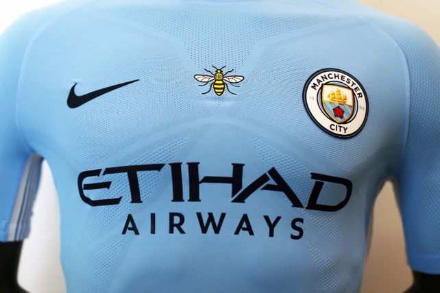 buy popular 1b503 f8a9b Add the Manchester bee to your Man City shirt