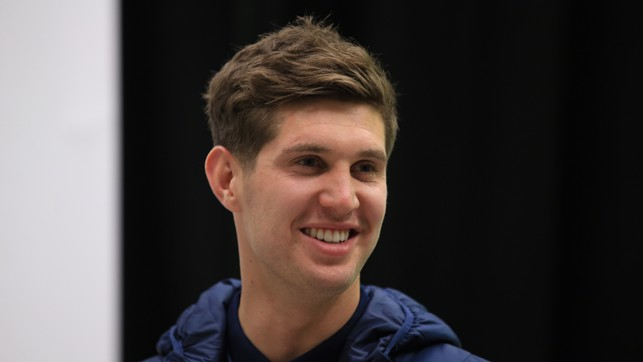 CHRISTMAS CHEER: John Stones flashes a smile.