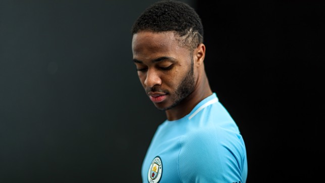 WHAT YOU LOOKING AT: Raheem perfects his pose.