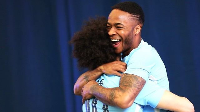 BEHIND THE SCENES: Leroy and Raheem embrace at the 2017/18 home kit launch.