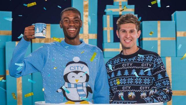 CHEERS: Tosin and John in this year's Christmas jumpers.