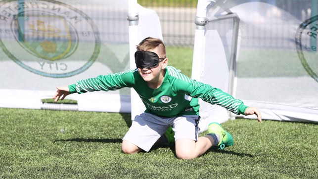 BLINDFOLD: A true test of goalkeeping skill.