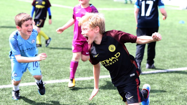 CELEBRATION: Young fans show off their skills a the Club's training ground.