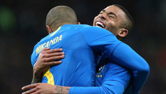 WHAT FUN! Miranda (not that Miranda) celebrates opening the scoring against Russia with Gabriel Jesus. Brazil went on to win 3-0