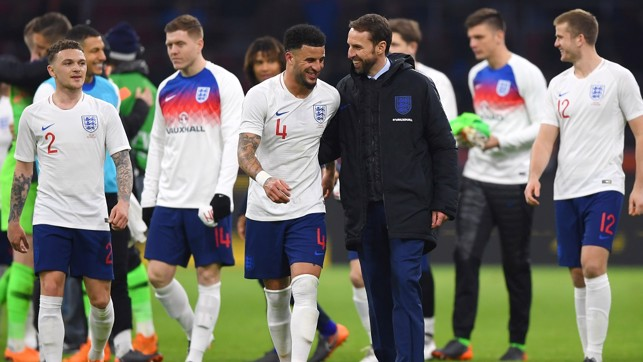 KYLE WALKER: Enjoys a chat with England boss Gareth Southgate after the 1-0 win in Amsterdam