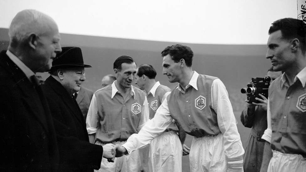As skipper of Arsenal in 1952 ahead of the FA Cup final against Newcastle United. Yes, that is Winston Churchill!