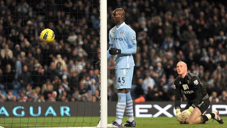 SHOULDER: Mario Balotelli scores with his shoulder