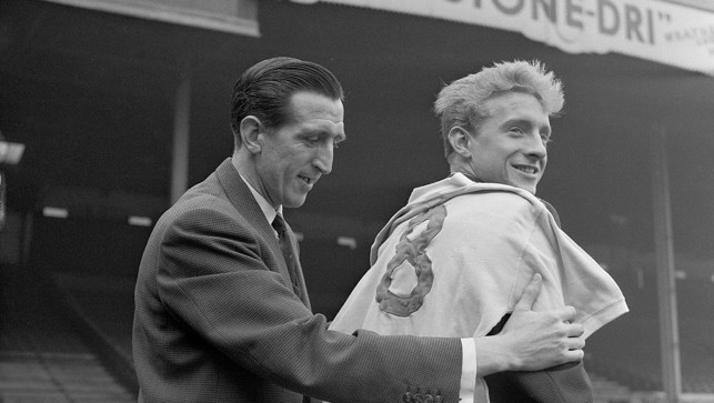 1960: This is how signings were once announced - low key! Denis Law (right) is welcomed by skipper Ken Barnes after signing from Huddersfield Town
