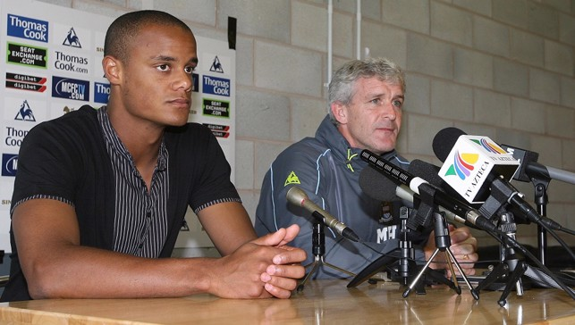 2008: Meet the press - Vincent Kompany and Mark Hughes attend a hastily arranged signing press conference