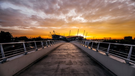 HOME: A beautiful sunset shot of the Etihad.